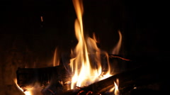 A looping clip of a fireplace with medium size flames - stock footage