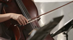 Musical quartet. Girl playing cello in a quartet of violinists. Close up. Stock Footage