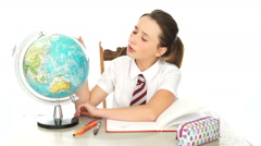 Pretty young school girl in geography class Stock Footage