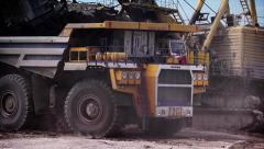 Stock video footage Mining truck stood for loading under excavator 2 Stock Footage