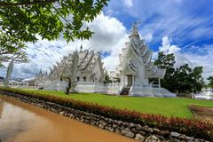 white temple - wat rong khun in chiang rai at sunny day - stock photo