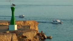 Egypt Sinai peninsula Sharm El-Sheikh 007 boats pass a lighthouse Stock Footage