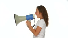 Angry young girl yelling into a megaphone Stock Footage