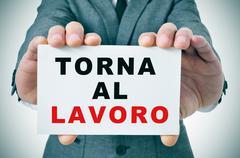 torna al lavoro, back to work in italian - stock photo
