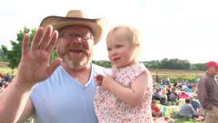 Happy Dad and Daughter Waiving to Camera Stock Footage