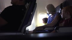 Grandmother with children flying Stock Footage