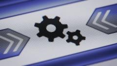 Gear icon on the screen. Looping. Stock Footage