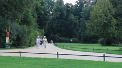 People strolling in the Muskau park - famous English garden in Europe. Stock Footage