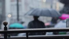 Rainy Day London _ Busy street scene people passing with umbrellas (slow motion) Stock Footage
