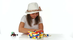 Young girl playing with colorful building blocks Stock Footage