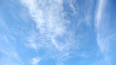 Time lapse clip of white clouds over blue sky - stock footage