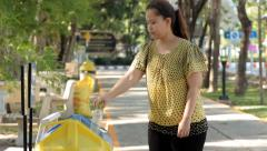 Woman putting plastic bottles in recycle container. Stock Footage