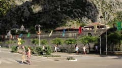 Tourists walking on the street and visit the old fortress. Mountain. Tilt up. Stock Footage