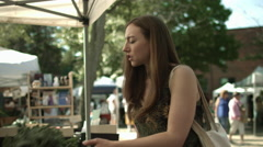 Woman buys kale at the market 4K - stock footage