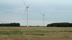 Wind turbines in a farmland Stock Footage