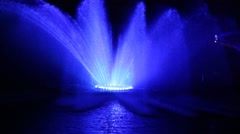 Musical fountain 'Roshen' with colorful illuminations at night in Ukraine - stock footage