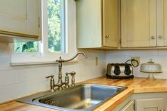kitchen cabinet with sink. view of faucet - stock photo