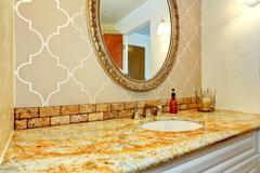 Bathroom vanity cabinet with granite top in luxury bathroom Stock Photos