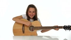 Young girl playing a guitar Stock Footage