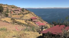 Peru Taquile lake overlook red roof houses and terraces 7 Stock Footage