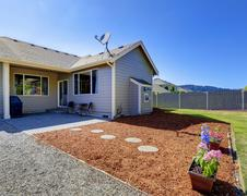 House exterior. walkout deck with sawdust and flowers Stock Photos