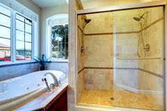 modern bathroom with whirlpool tub and glass door shower - stock photo