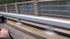 Motorcycle ride over a bridge Stock Footage