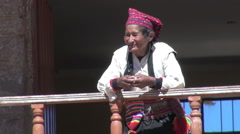 Peru Taquile old person in cap leans on balcony railing 19 - stock footage