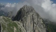 AERIAL: Flying over precipice towards the mountain peak Stock Footage