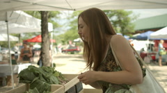 Stock Video Footage of Woman buying cabbages at farmers' market 4K
