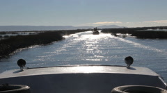 Peru Lake Titicaca boat trails another boat through sparkling water  Stock Footage