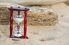 Sand timer in sand Stock Photos