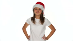 Pleased young girl in a Christmas Santa hat Stock Footage