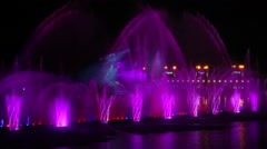 Musical fountain 'Roshen' with colorful illuminations at night in Ukraine Stock Footage