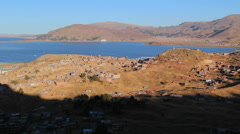 Peru Lake Titicaca houses spread across dry hills  Stock Footage