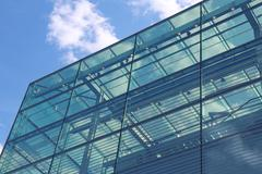 glass facade with clouds reflection - stock photo