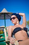 Young woman enjoying sun at the beach Stock Photos