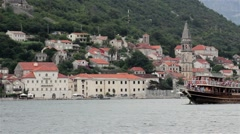 Ship with tourists passing through the sea bay. Beautiful seascape with old town Stock Footage