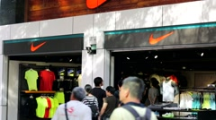 People visit Nike store. - stock footage