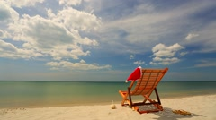 Sunlounger with Santa hat on a beach Stock Footage