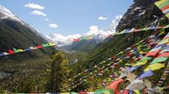Prayer flags and snow Mountains. Stock Footage