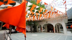 Flags at the Manikaran temple. Stock Footage