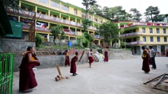 Tibetan monks play cricket. Stock Footage