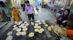 Volunteers cook Chapati Stock Footage