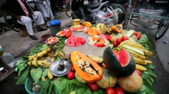 Street vendor sells fruits. Stock Footage