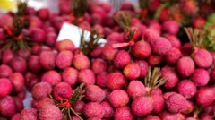Fresh lychees for sale Stock Footage