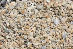 Eroded concrete on beach Stock Photos