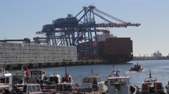 Port crane, containers and boats Stock Footage
