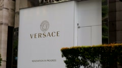 Stock Video Footage of Versace luxury fashion boutique.