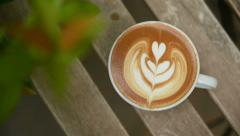Stock Video Footage of a cup of latte art coffee on table